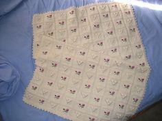 Ravelry: Rosebud Layette - Cardigan, Booties and Blanket pattern by Debbie Bliss