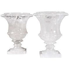 Pair of elegant Rock Crystal Urns of Excellent Quality | See more antique and modern Vases and Vessels at http://www.1stdibs.com/furniture/decorative-objects/vases-vessels