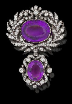 An amethyst and diamond brooch, circa 1820  The large oval mixed-cut amethyst, within a stylised laurel wreath border of old brilliant and rose-cut diamonds, suspending a detachable drop of similarly set amethyst and diamonds, mounted in silver and gold