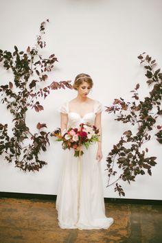 leafy garland backdrop - photo by Britt Taylor Photography http://ruffledblog.com/rich-toned-wedding-ideas-in-northern-california #weddingideas #backdrops