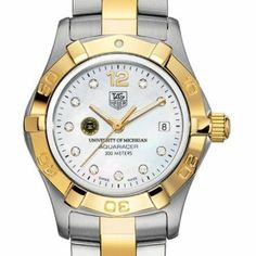 """University of Michigan TAG Heuer Watch - Women's Two-Tone Aquaracer Watch by TAG Heuer. $3395.00. Unique TAG Heuer presentation box.. Authentic TAG Heuer watch only at M.LaHart & Co.. Swiss-made Quartz movement.. TAG Heuer international two-year warranty. Officially licensed by the University of Michigan. University of Michigan TAG Heuer women's Aquaracer watch with Michigan seal in gold and black on diamond dial; """"University of Michigan"""" is written underneath. Brushed steel..."""