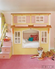 bunk bed house. Elle Decore. Create a facade to fit in front of a set of bunk beds you can buy used.