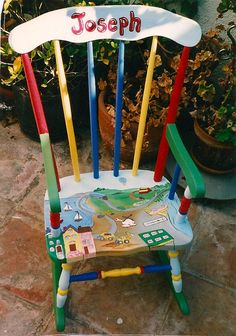 a rocking cahir painted with fun town images. May be personalized at no additional charge. Please add childs name in notes area when ordering/ size: x Paint Kids Table, Painted Kids Chairs, Painted Rocking Chairs, Childrens Rocking Chairs, Kids Table And Chairs, Diy Kids Furniture, Hand Painted Furniture, Art Furniture, Girls Toy Box