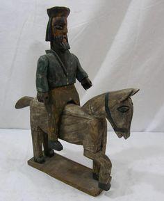 carved figure on horse, folk art...