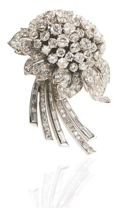 Gorgeous diamond brooch set with circular-, single-cut and baguette diamonds was made by Jacques Lacloche, circa 1937. (Via Sotheby's.)