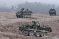 Stryker armored combat vehicles patrol USAG Bavaria's new convoy live-fire course during its opening, Dec. 18, 2013. (MICHAEL DARNELL/STARS AND STRIPES) #military