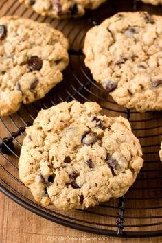 Oatmeal Raisin Chocolate Chip Cookies - chewy and packed with goodies! These oatmeal cookies are bound to be a hit! Oatmeal Raisin Chocolate Chip Cookies Recipe, Chip Cookie Recipe, Oatmeal Cookie Recipes, Homemade Chocolate, Chocolate Recipes, Chocolate Chocolate, Cookie Calories, Dessert Recipes, Desserts