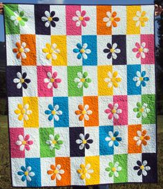 Crib or lap quilt featuring appliqued flowers by PiecesOfCotton, $125.00