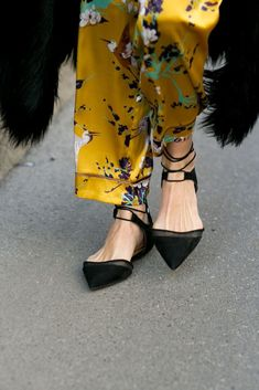Point-toe flats and floral pants.