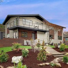 remodeled mid-century modern. we have a lot of these in our area, and I love the more modern take on this house.