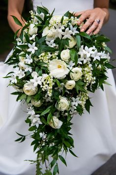 1940s Waterfall bouquet with hanging ivy, gardenias, stephanotis, ranunculus, spray roses. Vogue's Lindsay Talbot Wedding Estate Cascading bouquet via VOGUE.com