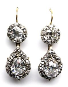 Pair of 18th century diamond drop earrings, c.1780   , each cluster surmount set with a central cushion-shaped diamond to a circular-cut diamond surround, suspending a pear-shaped diamond drop, swing set within a frame of circular-cut stones, drops detachable, mounted in silver and gold   Length 3.7cm / 1 1/2''