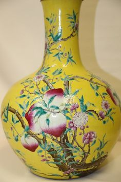 "A Magnificent Yellow Ground ""Nine Peaches"" Famille Rose Porcelain Bottle Vase, Underglaze blue seal mark Qianlong and Probably Period H 53cm"
