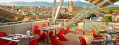 Hotel Marques de Riscal, Elciego. Bistró 1860 offers traditional, seasonal cuisine in an avant-garde, yet casual atmosphere—serving delicious, healthy recipes prepared with seasonal produce complemented by superb wines. From its sun-drenched terrace, Bistró 1860 offers stunning views of the village of Elciego with the Cantabria mountain range as a backdrop, all right under Frank Gehry's unmistakable canopies.