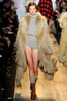 oversize fur coat, boots, & wool hot pants? im with that. michael kors fall 2012.