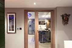 The Trem Glass door features a large, central glass panel that allows light to flood any room as well as creating a stunning central feature. Explore this style through our range of finishes below. Contemporary Internal Doors, Door Design, House Design, Glass Panels, Glass Door, Bathroom Medicine Cabinet, Garage, Mirror, Luxury