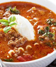 LASAGNA SOUP  Serves 8  Ingredients  1 1/2 pounds Italian sausage 1 (28 oz.) can crushed tomatoes 10 oz. lasagna noodles, broken into smaller pieces 8 oz. fresh kale, optional 4 cups low-sodium chicken stock 2 cups water 1 cup ricotta cheese 1 cup white onion, chopped 1/2 cup parmesan cheese, grated 2 bay leaves 3 large cloves garlic, minced 2 tablespoons tomato paste 2 tablespoons extra-virgin olive oil 1 teaspoon dried basil 1 teaspoon dried oregano 1/2 teaspoon red pepper flakes kosher…