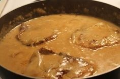 Cooking smothered pork chops is easy with this soul food recipe. This pork chop recipe calls for a delicious onion gravy, served with rice, a vegetable side item and corn bread. Pork Chop Recipes, Meat Recipes, Cooking Recipes, Syrian Recipes, Cooking Kale, Amish Recipes, Dishes Recipes, Hamburger Recipes, Smothered Pork Chops Recipe