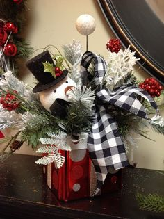 Floral arrangement on mantel in the red and white room at Something Special. Christmas decorating ideas.