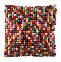 Our felt-ball cushions are a fun and creative way to brighten up any interior. Absolutely ideal for a child's bedroom, the felt-ball cushion is made from 100% soft wool and is incredibly durable. A perfect match with our 100% soft wool felt-ball rug and garland.