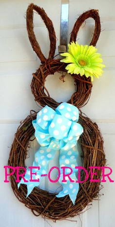 - Easter Bunny Wreath - Spring Wreath - Summer Wreath - Easter Door Decoration. $54.00, via Etsy.