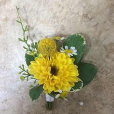 Groom's boutonniere with a Viking mum, billy ball, and fever few accents #craspedia #minisunflower