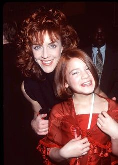 Andrea McArdle, the original Annie, and Alicia Morton, Annie in the 1999 Television version.