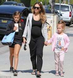 Expecting: Jessica Alba, 36, showed off her baby bump as she was spotted out with her daug...