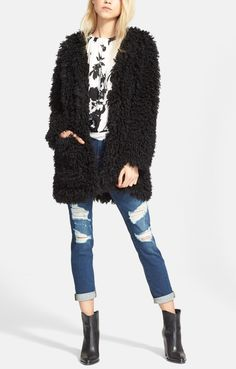 A shaggy faux-fur coat in a loose shape and simplified styling is the epitome of effortless layering—all the glamour, with still a casual-chic vibe.
