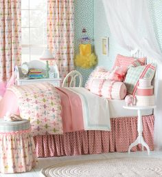Matilda Kids Bedding Collection by Eastern Accents  Get a little girly with Matilda. This ballet-inspired kid's bed is everything a little girl could wish for! Light pinks, purples, and apple greens mix with pretty appliqués of glitter and roses so your princess can feel like the belle of the ball. Personalize her bedroom with a silver hand-painted monogram pillow to make it extra-special.