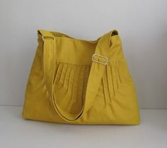 Mustard Canvas Lines Multi-Purpose Bag with Extra Pockets by Tippy Thai $35