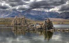 Mono Lake, CA boasts weird rocks formations, called tufas. Essentially, a common rock --limestone -- that forms in uncommon circumstances --underwater.  A number of Mono's tufa formations are now hundreds of feet from the shore, a testament to just how much the lake's water level has fallen.  The LA water department has committed to filling the lake back up to 1940s levels, which means there will be fewer tufa to check out in years to come. So visit while the visitin's good!