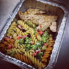 Herb baked chicken and rainbow pasta salad with red pepper, broccoli and cranberries