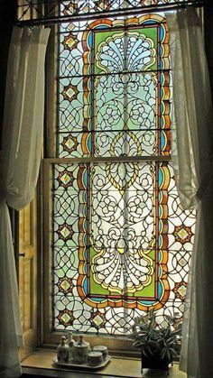 Beautiful stained glass window. #StainedGlassBathroom