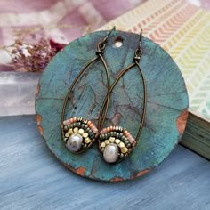 These fabulous lightweight earrings feature mystic-coated Moonstone gemstone beads, glass seed beads, brass metal beads, brass wire, hypoallergenic artisan niobium earwires Length: approx 2.75 inches and VERY lightweight; the wire hoops are approx 50mm long. Buyer receives 1 pair of exact