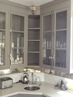 Cremone bolts on kitchen cabinets. All elements in Polished Nickel, rods in Gun Metal.