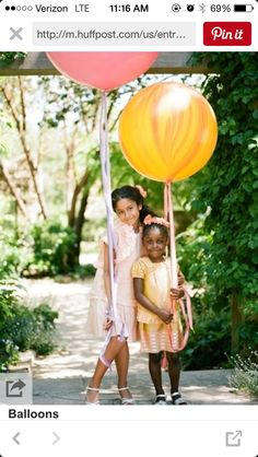Flower girls holding decorated balloons instead of tossing out flowers! Great way to save money on flower petals!! <3:-)