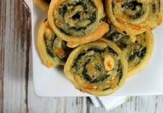 Flaky puff pastry with melted cheese and garlicky spinach, shaped into cute…