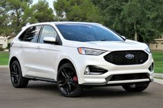 Ford Edge gets a performance boost with the ST model, which replaces the Edge Sport and emulates the sharply tuned Fiesta ST and Focus ST models. Ford Edge Suv, Beach Gear, Sport Seats, The St, Automatic Transmission, Paddle, Cars For Sale