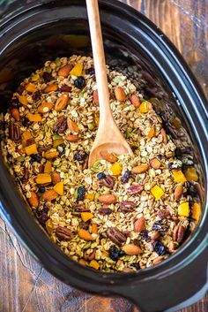 The BEST, easiest homemade granola ever! Crock Pot Granola. Simple, healthy, and the slow cooker does the work. Add any of your favorite fruits, nuts, and chocolate chips. DELICIOUS. {vegan, dairy free, gluten free} Recipe at wellplated.com @Well Plated