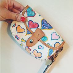 Dooney & Bourke keychain wallet Keychain wallet, a small amount of makeup in inside! May be able to wash off Dooney & Bourke Bags Wallets