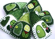Set of three little hanging houses, handmade with felt and vintage cottons in green and white. The roofs, doors and windows are hand- appliqued with vintage cotton fabrics, embroidered berries grow on
