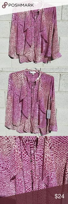 Brand new with tag Jennifer Lopez blouse size M Brand new with tag Jennifer Lopez woman size medium. Very pretty patterns of purple and pink with curly lace detailing and buttons in the front. Sher button down blouse. Jennifer Lopez Tops Blouses