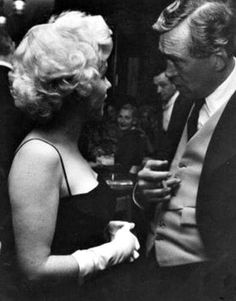 Marilyn with director John Huston at Club 21, 1955.