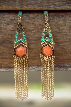 Fun fringe dangle earrings with jewels and tribal etching.