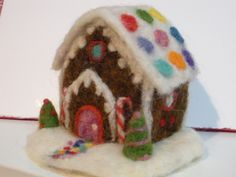 Needle felted gingerbread cottage.
