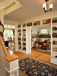 . Clean look.  Semi-empty shelves.  White,Built In Bookcase Around Double Glass Door Design, Pictures, Remodel, Decor and Ideas - page 5
