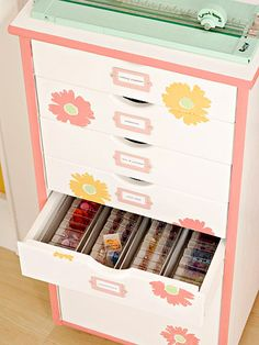 Painted Cabinet - Paint a small cabinet and stamp it with fresh flowers for a pretty, mobile crafts storage unit. Add dividers to the drawers to bring order to the goodies inside. Attach metal label holders to the fronts of the drawers to make it easy to identify what is stored in each.