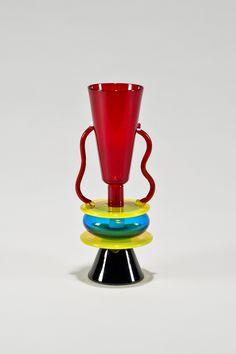 "Artist/Designer: Ettore Sottsass b. 1917 Innsbruck, Austria - 2007 Milan, Italy Title: Sirio Vase Medium: Hand blown multicolored glass Dimensions: 14""h x 6"" x 5.5"" Manufacturer: Memphis/Milano 1982 D"