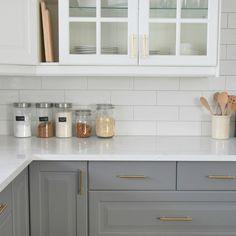 Beau A Grey And White Kitchen Featuring A White Subway Tile Backsplash, IKEA  Cabinets, Hardwood